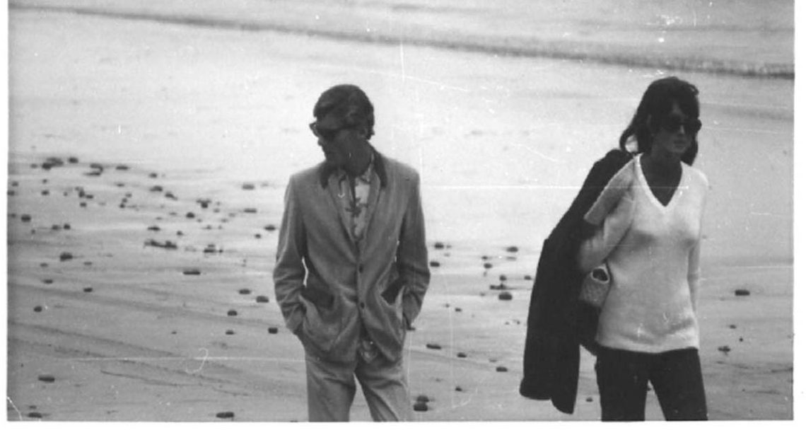 Mike Hynson & Melinda walk on beach